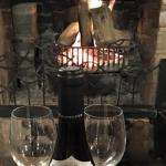 Enjoy our roaring open fire with a bottle