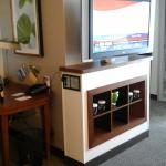 TV swivels to turn towards sitting area or bed- Glass glasses only provided