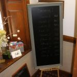 Chalk board with guest names & room numbers