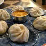Momo (chicken dumplings) with spicy Nepalese chutney