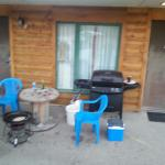 table outside of our room, old solid grease in the grill, box knife and other tools laying aroun