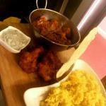 Homemade chicken tikka masala,  onion bhajis poppadom and scented rice.