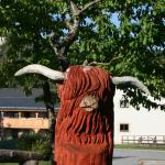 Cute hairy coo wood sculpture