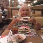 My wife enjoying the food.