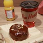 Reese's pieces chocolate donut, coffe and OJ