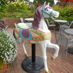 A merry go-round horse greets you!