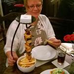 Enjoying the hanging kebab skewer speciality