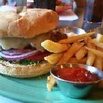 The burger and fries in DJs Resturant & Lounge