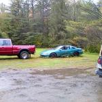junk cars in their lot, all puddles, no paving