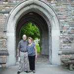 My husband & I in front of the arch at the bell tower