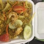 To go- still tastes amazing...Curry fried rice w/shrimp, spring rolls (3), chicken satay w/ pean