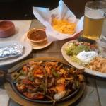 Sizzling Fajita Platter with an ice cold brew... come to think of it, i could use one now!