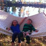 Kids enjoying hammock on the lake