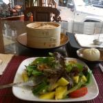 Mango salad, steamed dumplings , iced tea