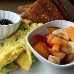 avocado omelette with fresh fruit and toast