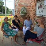 Ladies sipping wine on the veranda.
