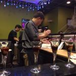 Oyster shooters with Cardinal Winery Jalapeno wine with Chef Ray working in the background