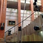 Staircase of the hotel filled with artworks