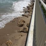 There is almost no beach left due to erosion.
