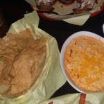 Buffalo chicken dip served with fries. Mild in spiciness, creamy base, chunks of chicken.