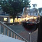 Pre-dinner glass of wine on the deck at Chesca's, overlooking Water Street at dusk