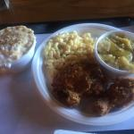 Fried chicken leg, thigh, squash, macaroni and cheese, banana pudding
