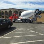 Cement mixers coming all day in parking lot, noisy and dangerous