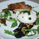 Burrata with cherry tomatoes, black olive, marinated anchovy, arugula and pine nuts