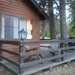 """the cabin deck with Adirondack chairs """"River"""" cabin"""