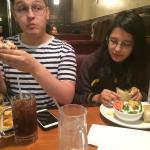 My kids eating chicken teriyaki wrap, salad, club sandwich and fries