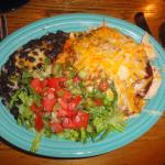 Red chile enchiladas with black beans.