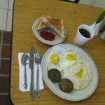 Regular breakfast (eggs,sausage patties, grits,coffee & toast