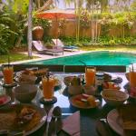 In villa served breakfast overlooking stunning pool