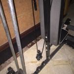 Broken universal weight machine in gym