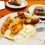 Breakfast platter with fried chicken and blueberry biscuit.