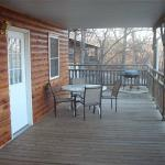 Just one of the covered porches on a cabin at Ventris Trail's End Resort