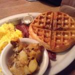 Pecan waffle, potatoes, eggs and bacon