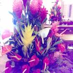 These tropical floral arrangements fill the reception area