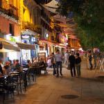 Calle Preciados at night, next to the hotel
