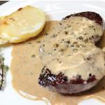 Steak au Poivre Eye fillet steak cooked in a pepper brandy sauce.