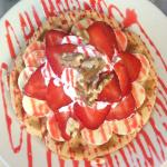 Waffle with fresh strawberries, walnut, cream and drizzled with rose syrup!