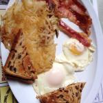 2 eggs, hash browns, raisin toast and bacon! Delish!