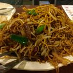 Deep fried barbeque pork chow mein with bean sprout.
