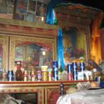pilgrims leave their favorite beverages as offerings