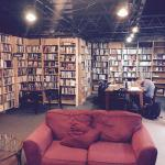 """A very comfortable """"back"""" room with sofas and many, many books."""