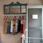 Entrance with railroad stakes for pegs for the variety of aprons handing @ the door.
