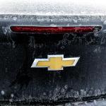 frozen car on the far parking side