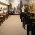 Our dining room offers cozy seating while you eat enjoy reading bits of local history on the wal