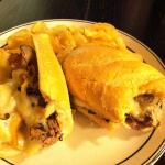 Our philly cheesesteak is loaded with thinly sliced roast beef and melted cheese.