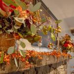 Hand hewn 250+ year old mantle decorated for fall wedding.